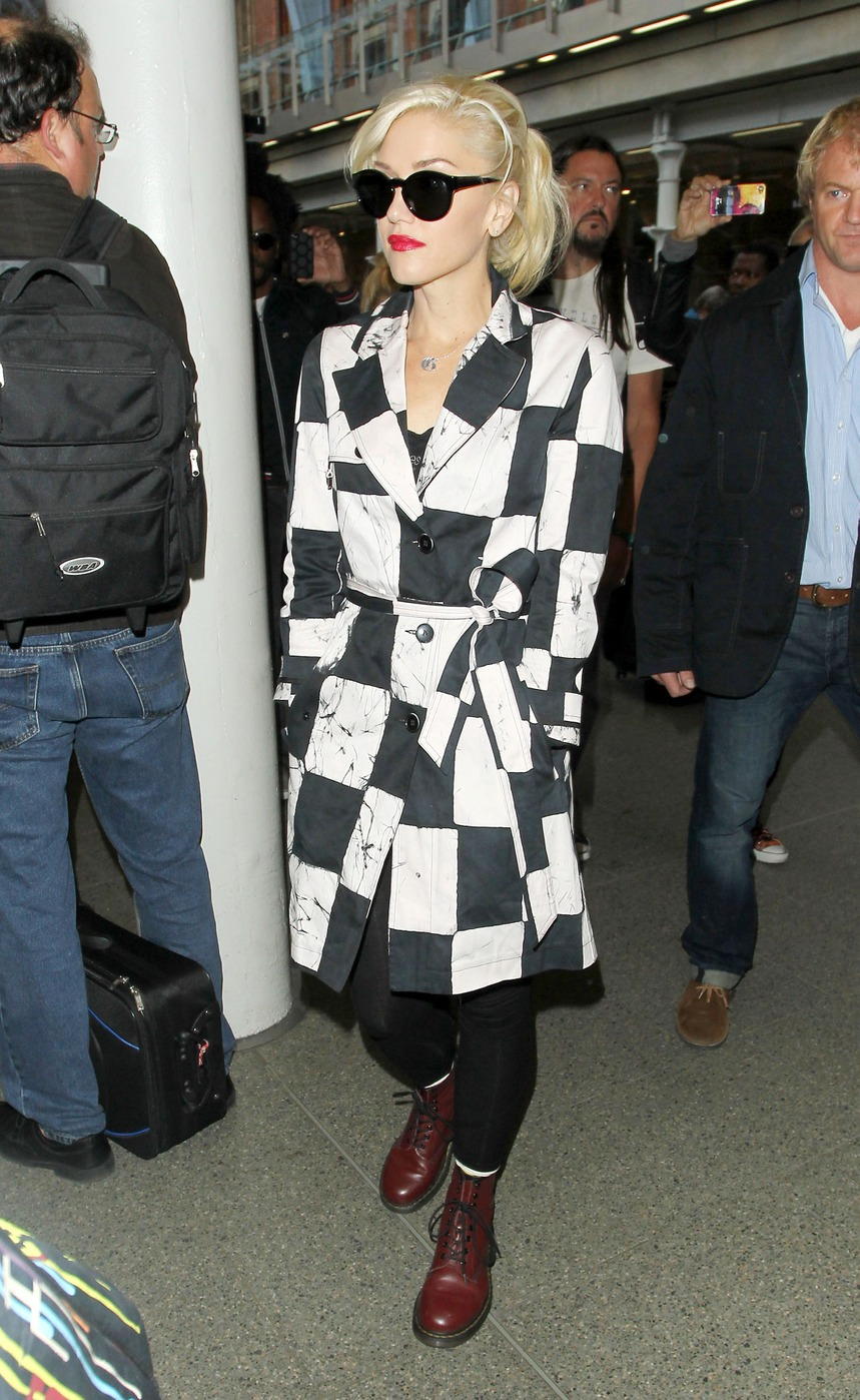 Singer Gwen Stefani shows off her style as she arrives in London via the Eurostar from Paris in a checkered jacket