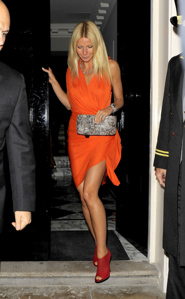 "Gwyneth Paltrow wears a clashing combo of orange and red as she helps handbag designers ""Coach"" celebrate their 70th anniversary at the Mayfair Arts Club in London"