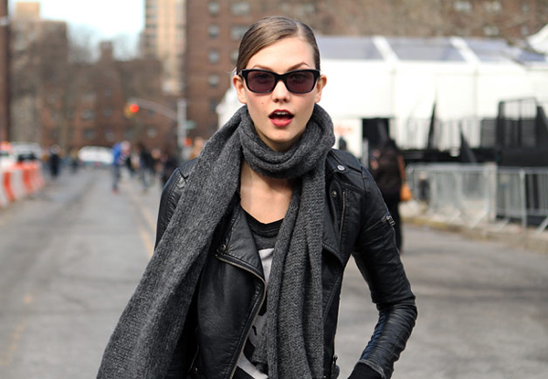 karlie+kloss-+candid+photo-+black+leather+jacket-+bright+magenta+lips-+scarf-+casual+outfit